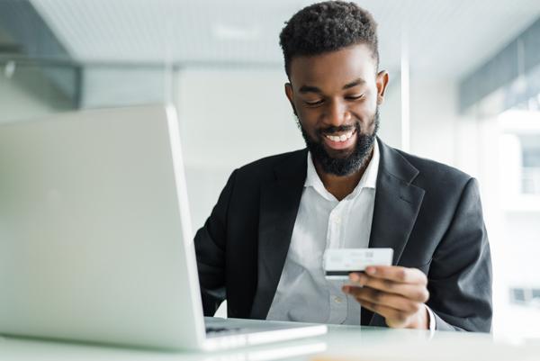 Man at computer with credit card